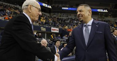Syracuse Orange head coach Jim Boeheim (left) and Pittsburgh Panthers head coach Jeff Capel (right) shake hands before their game at the Petersen Events Center.