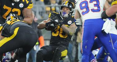 Pittsburgh Steelers running back James Conner (30) looks for a hole against the Buffalo Bills during the third quarter at Heinz Field. The Bills won 17-10.