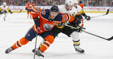 Pittsburgh Penguins forward Sidney Crosby (87) tries to check Edmonton Oilers forward Connor McDavid (97) during the first period at Rogers Place.