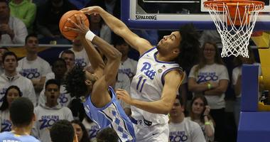 Pittsburgh Panthers guard Justin Champagnie (11) defends North Carolina Tar Heels guard Leaky Black (1) during the second half at the Petersen Events Center. Pittsburgh won 66-52.