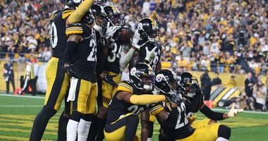 The Pittsburgh Steelers defense celebrates an interception in the end-zone by inside linebacker Mark Barron (26) against the Cincinnati Bengals during the fourth quarter at Heinz Field.