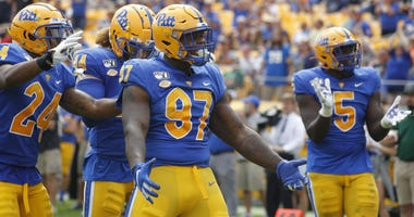 Pittsburgh Panthers linebacker Phil Campbell III (24) and linebacker Elias Reynolds (44) and defensive lineman Jaylen Twyman (97) and defensive lineman Deslin Alexandre (5) celebrate a defensive stop ...