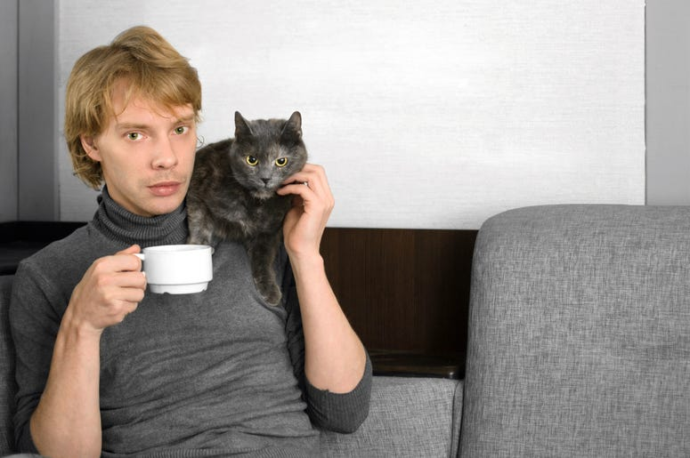 Man holds cat
