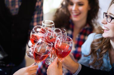 Wine tasting event by happy people concept.