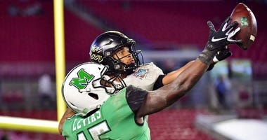 Tay Gowan #23 of the UCF Knights breaks up a pass intended for Armani Levias #15 of the Marshall Thundering Herd during the fourth quarter at the Bad Boy Mowers Gasparilla Bowl at Raymond James Stadium on December 23, 2019 in Tampa, Florida