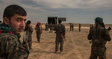 U.S.-backed Syrian fighters work to defeat ISIS