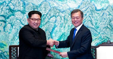 FILE - In this April 27, 2018 file photo, North Korean leader Kim Jong Un, left, and South Korean President Moon Jae-in shake hands.