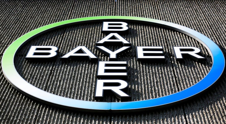 0      1      0  FILE - This Monday, May 23, 2016, file photo, shows the Bayer AG corporate logo displayed on a building of the German drug and chemicals company in Berlin.