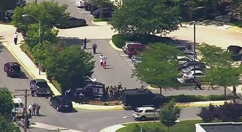 In this frame from video, people leave the Capital Gazette newspaper after multiple people have been shot on Thursday, June 28, 2018, in Annapolis, Md.