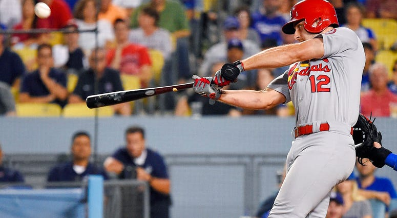 St. Louis Cardinals' Paul DeJong hits a two-run home run during the ninth inning of a baseball game against the Los Angeles Dodgers on Wednesday, Aug. 22, 2018, in Los Angeles.