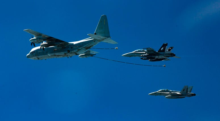 U.S. Marine Corps, two F/A-18D Hornets with Marine All-Weather Fighter Attack Squadron.