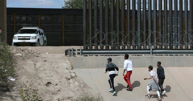 A group of asylum seekers cross the border between El Paso, Texas, and Juarez, Chihuahua, Mexico, Thursday, July 4, 2019.