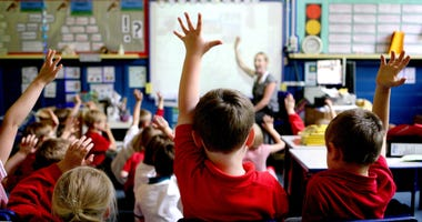 Classroom Kids Hands up © Press Association.jpg