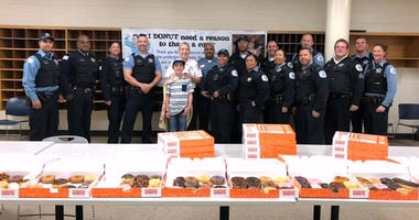 Boy has bought more than 60,000 doughnuts for cops.