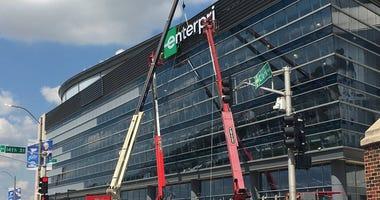 Signage at the Enterprise Center goes up.