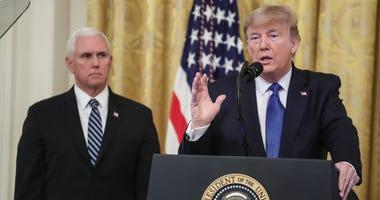 Mike Pence and Donald Trump at podium