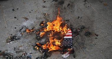 American flag, fire
