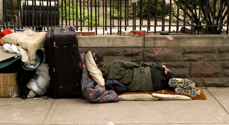 homeless person on sidewalk