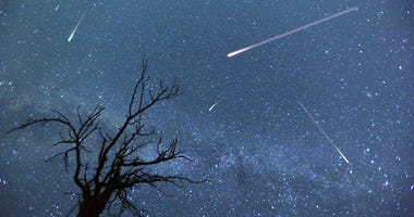 meteors and stars in the night sky