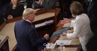 Nancy Pelosi offers her handshake to Donald Trump SOTU 2-4-20