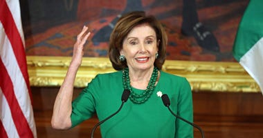 Nancy Pelosi in Green © Press Association.jpg