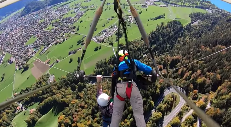 Hang glider nearly falls.