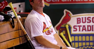 Caption:  Jun 6, 2018; St. Louis, MO, USA; St. Louis Cardinals manager Mike Matheny (22) watches from the dugout during the sixth inning against the Miami Marlins at Busch Stadium.