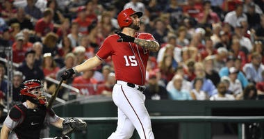 Aug 4, 2018; Washington, DC, USA; Washington Nationals first baseman Matt Adams (15) watches his solo home run during the fifth inning against the Cincinnati Reds at Nationals Park.