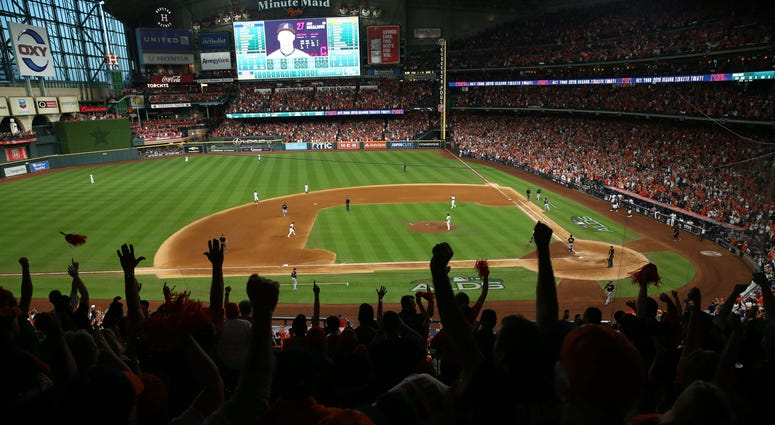 Houston Astros fans celebrate after defeating the Cleveland Indians
