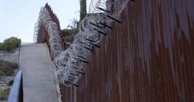 Border fence near DeConcini crossing at Arizona-Mexico border in Nogales, Arizona