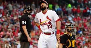 Matt Carpenter of the St. Louis Cardinals reacts to back injury.