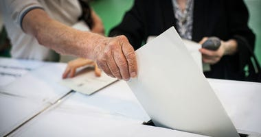 Voter casting a ballot at a polling place