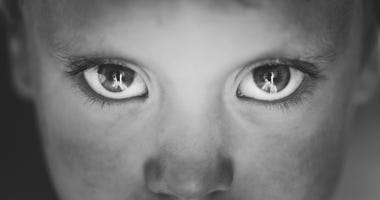 close up of child's eyes in grayscale