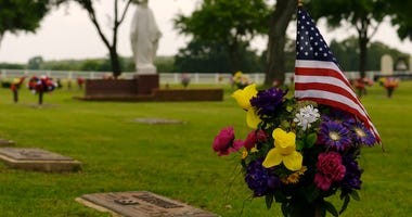 An American Flag marking the grave of a deceased veteran