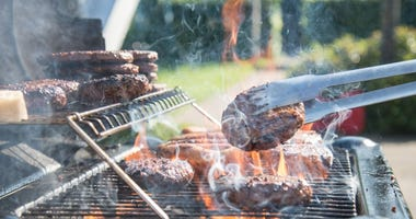 barbecue grill with burgers