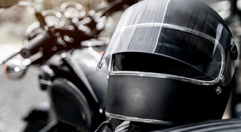 helmet on seat of motorcycle