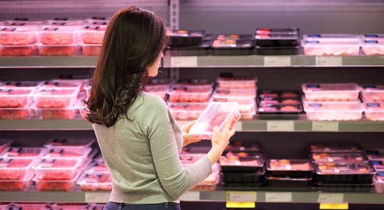 woman shopping in meat aisle