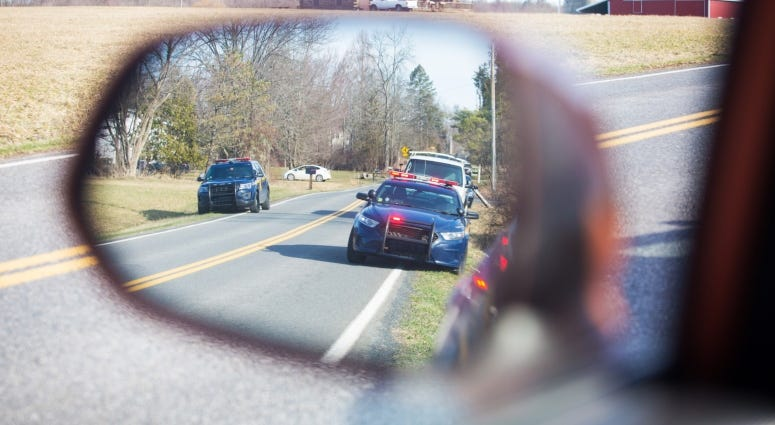 mirror with police cars in reflection