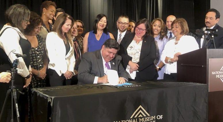 JB Pritzker signing bills into laws