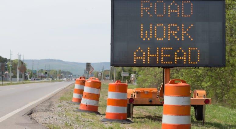 road work ahead sign on highway