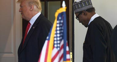 President Donald Trump, left, welcomes Nigerian President Muhammadu Buhari, right, to the West Wing of the White House in Washington, Monday, April 30, 2018. (AP Photo/Susan Walsh)