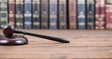gavel on top of table in front of books