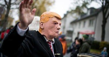 man wearing Trump mask