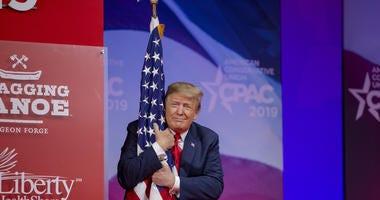 Trump hugs flag