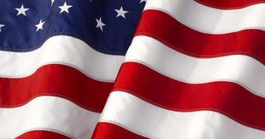 Waving American Flag Iconic Symbol of Patriotism Closeup.