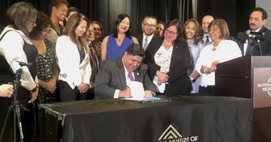 JB Pritzker signing bills into laws