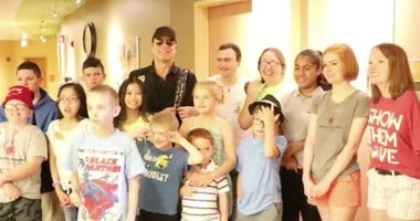Tom Gimbel of Foreigner visits children at Shriners Hopsital