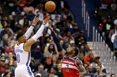 Russell Westbrook #0 of the Oklahoma City Thunder shoots over John Wall #2 of the Washington Wizards during the second half at Capital One Arena on November 2, 2018 in Washington, DC.