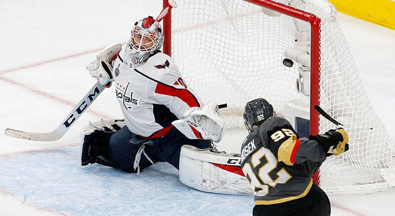 Washington Capitals goaltender Braden Holtby, left, is scored on by Vegas Golden Knights left wing Tomas Nosek, of the Czech Republic, during the third period in Game 1 of the NHL hockey Stanley Cup Finals Monday, May 28, 2018, in Las Vegas. (AP Photo/Ros