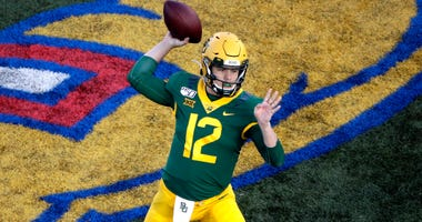 Baylor quarterback Charlie Brewer passes the ball during the first half of an NCAA college football game against Kansas, Saturday, Nov. 30, 2019, in Lawrence, Kan.